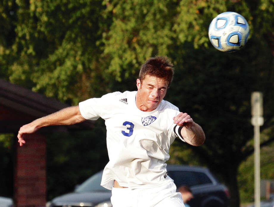 Marquette's Adam Johnes heads the ball during the Explorers' match against Waterloo Gibault last Tuesday night Moore Park in Alton. The Explorers were back on their home field Monday night for a nonconference match with Edwardsville. Photo: James B. Ritter / For The Telegraph