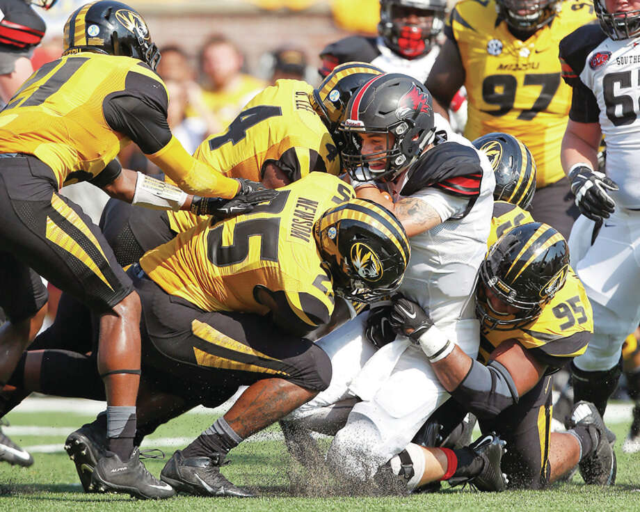 Southeast Missouri State Redhawks quarterback Tay Bender (3) is tackled by a host of Missouri Tigers defenders in Saturday's game at Faurot Field in Columbia. Mizzou is ranked No. 20 in this week's Associated Press Top 25 Poll. Photo: Billy Hust | For The Telegraph