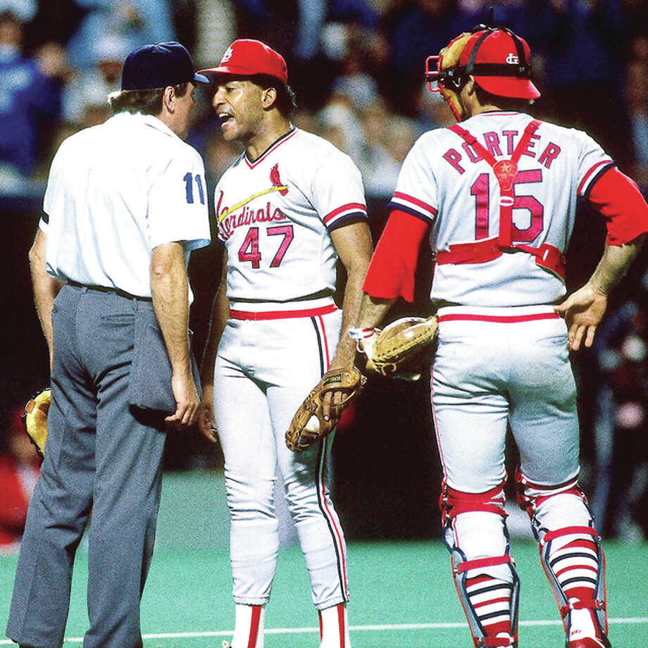 Cadinals pitcher Joaquin Andujar, center, argues with an umpire during postseason action during the 1985 playoffs. At right is Cardinals catcher Darrell Porter, who died in 2002. Photo: MLB Photo