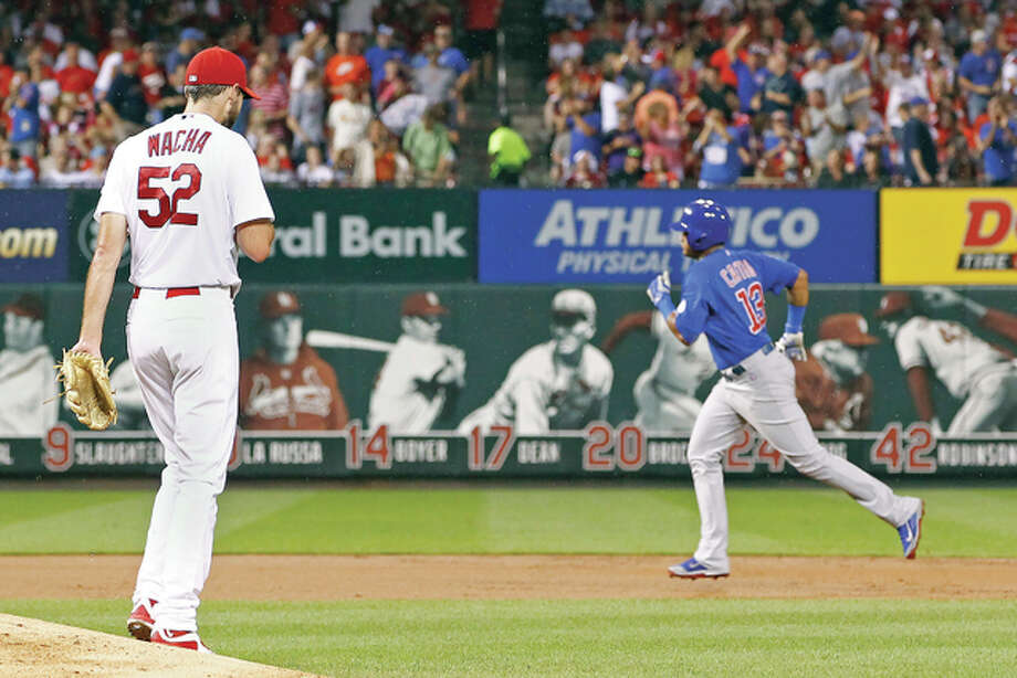 Cardinals starting pitcher Michael Wacha, left, reacts as the Cubs' Starlin Castro rounds the bases after hitting a three-run home run in the second inning Monday night at Busch Stadium. Photo: Billy Hurst | For The Telegraph