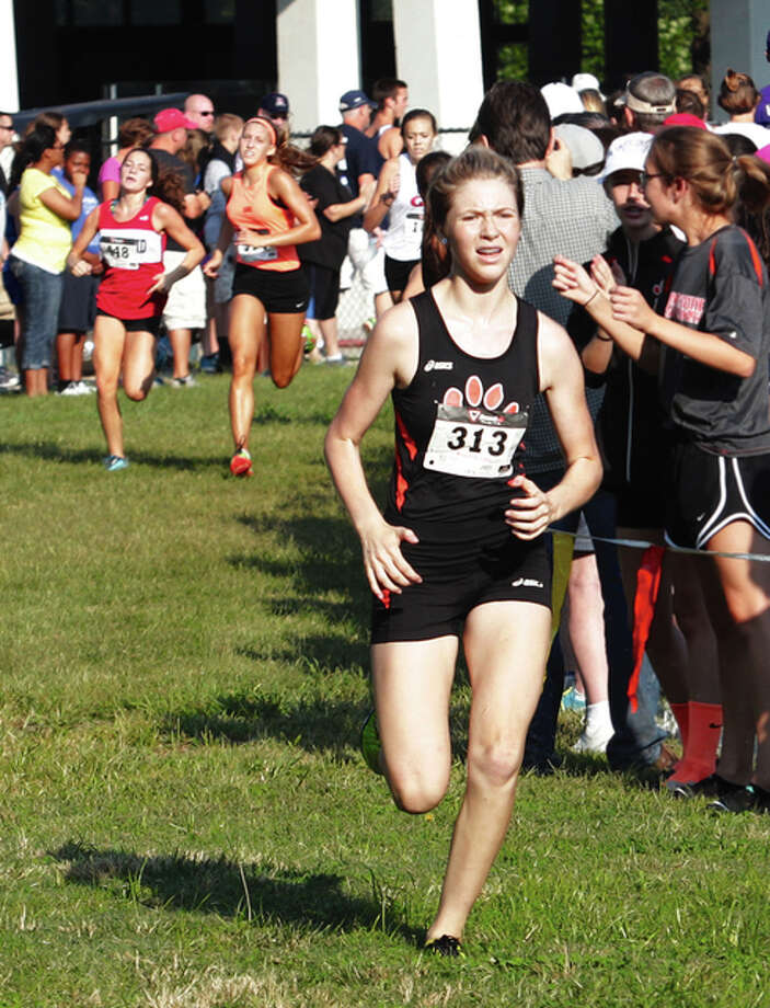 Edwardsville's Honor Dimick, shown on the final turn at the Granite City Cross Country Invitational on Saturday, came back Wednesday with a third-place finish at the Tiger Fall Classic at SIUE to lead the Tigers to the team title. Photo: James B. Ritter / For The Telegraph