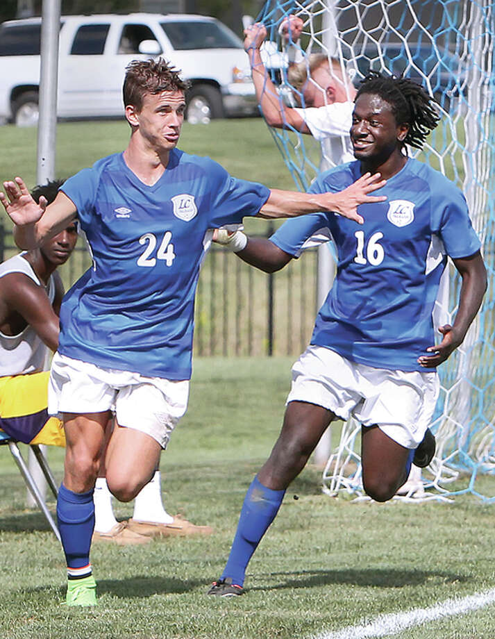 Lewis and Clark Community College's Connor Clasby (24), and Markell Saddler (16) celebrate a goal Thursday by Clasby as SWIC's Tyler Enright clutches the inside of the goal in the background. Photo: S. Paige Allen | For The Telegraph