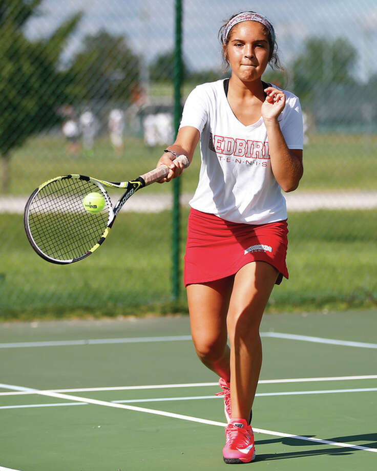 Alton freshman Hannah Macias, shown at a match earlier this season against Metro East Lutheran at Edwardsville, posted the lone singles victory for the Redbirds in Tuesday's dual loss to Marquette Catholic in Godfrey. Photo: Billy Hurst / For The Telegraph
