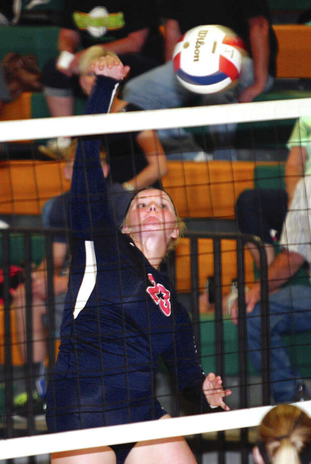 Carlinville's Alyssa DeSpain swings for a kill during the Cavaliers' SCC defeat to Southwestern on Tuesday night at Piasa. Photo: James B. Ritter / For The Telegraph