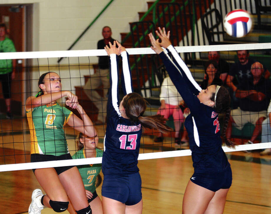 Southwestern's Hannah Blumstein (left) hits over the block put up by Carlinville's Lynde Gibbs (middle) and Anna Chew (right) during the Piasa Birds' South Central Conferene victroy Tuesday night in Piasa. Photo: James B. Ritter / For The Telegraph
