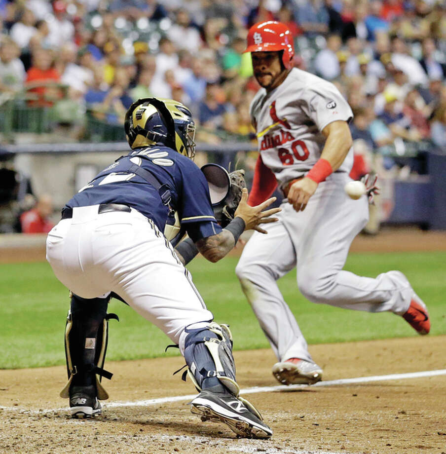 Brewers catcher Martin Maldonado (left) tags out the Cardinals' Thomas Pham at home during the sixth inning Wednesday in Milwaukee when Pham tried to score from third on a ball hit by Jaime Garcia. Photo: Associated Press