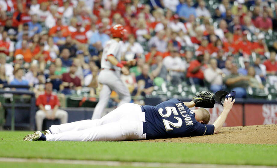 Milwaukee Brewers starting pitcher Jimmy Nelson lays on the ground after being hit in the head with a ball hit by the Cardinals' Tommy Pham in the third inning Thursday in Milwaukee. Photo: Morry Gash | Associated Press