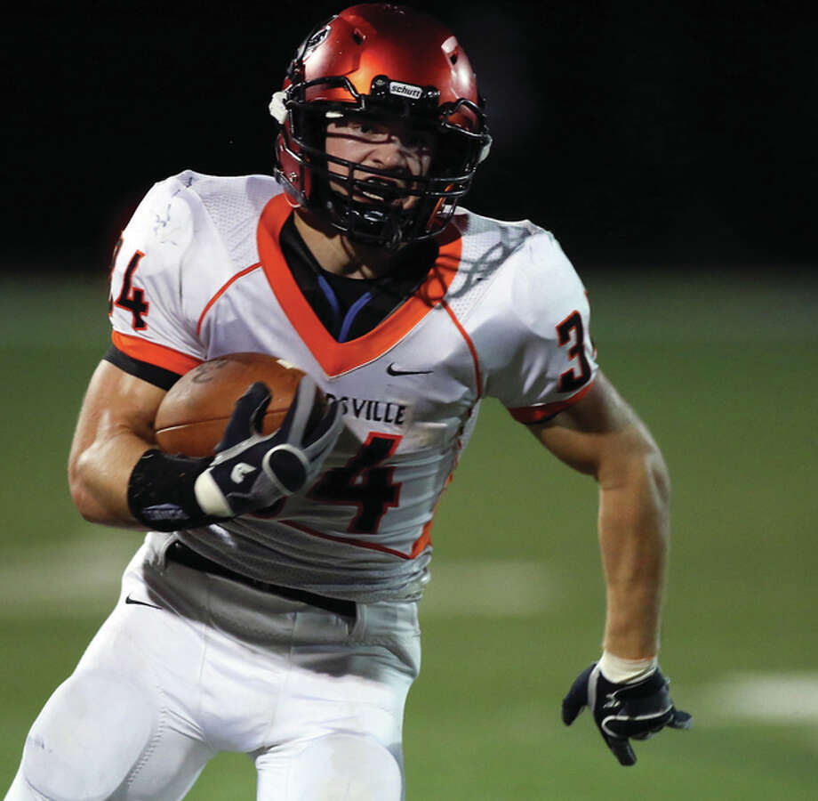 Edwardsville's Jackson Morrissey turns the corner for some of his 111 rushing yards in the Tigers 24-10 victory Friday night at O'Fallon. Photo: Scott Kane / For The Telegraph