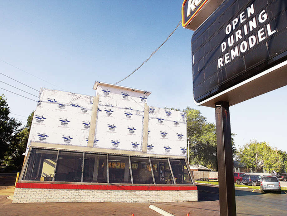 The Wood River Dairy Queen restaurant is getting a facelift but remains open during the remodeling process. The national chain's concept for an updated menu with sandwiches, hot treats and snacks is aimed at creating a hybrid atmosphere between fast service and casual dining.