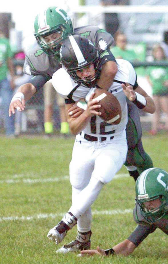 Carrollton's Jerrett Smith tackles West Central quarterback Caleb VanDeVelde Saturday in Carrollton. Photo: Rob Evans, Journal-Courier   For The Telegraph