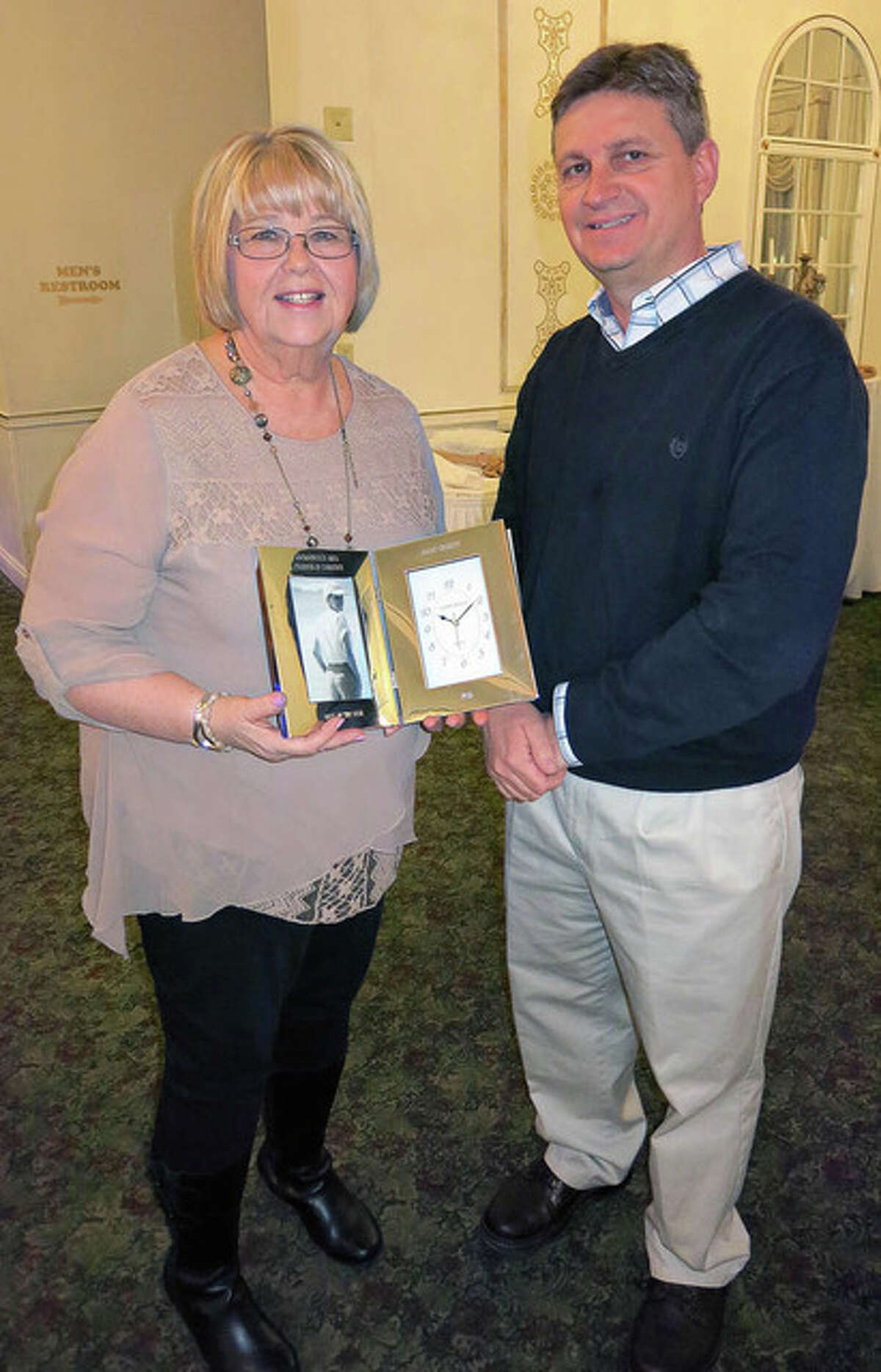 Submitted photo JoAnn Chumley, owner of All Occasions Flowers and Gifts, shows the award recognizing her as the 2015 Boss of the Year.