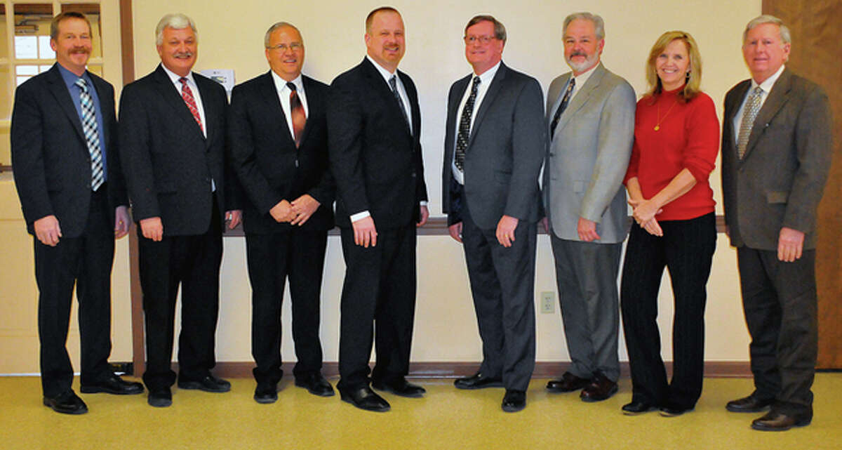 Photo submitted Petefish, Skiles & Co. President Tom Prather will be stepping down from his leadership role this week, but will remain on the bank's board of directors. The board includes Ron Brockhouse (from left), Eldon Leinberger, Steve Bitner, Paul Reynolds, Prather, Stan Fulton, Nancy Bley-Cowen and Donald Gillmore.