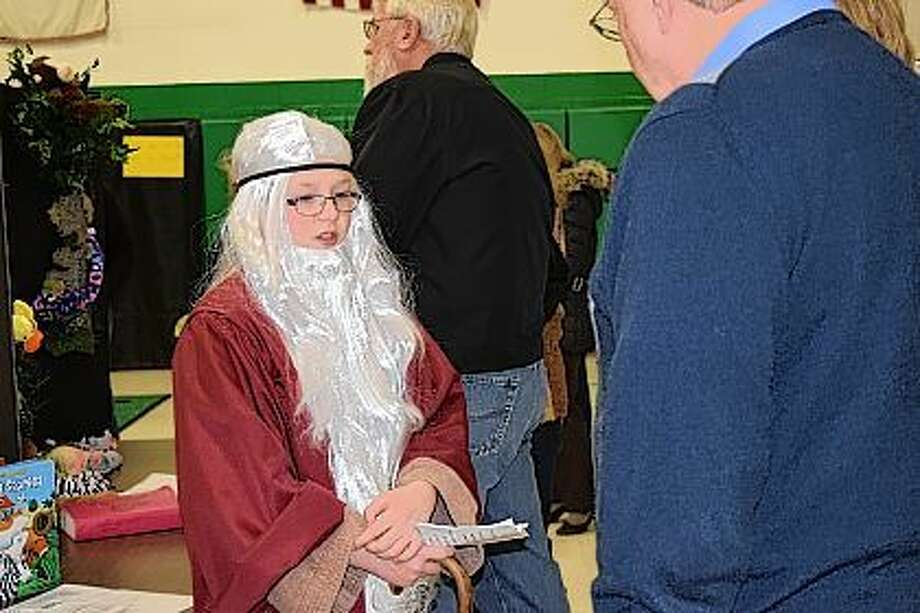 Alex Dufelmeier, a fifth grader at Salem Lutheran School, is dressed as Noah during the Walk Through the Bible event Tuesday at Salem Lutheran School. Each student from the school dressed as a Bible figure and told their stories. Photo: Samantha McDaniel-Ogletree | Journal-Courier