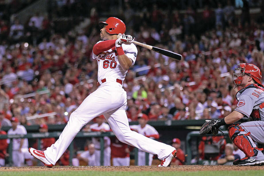 The Cardinals' Tommy Pham hits a sacrifice fly that drives in Tony Cruz to give the Cards a 2-1 lead in the seventh inning Tuesday night at Busch Stadium. Photo: Billy Hurst / For The Telegraph