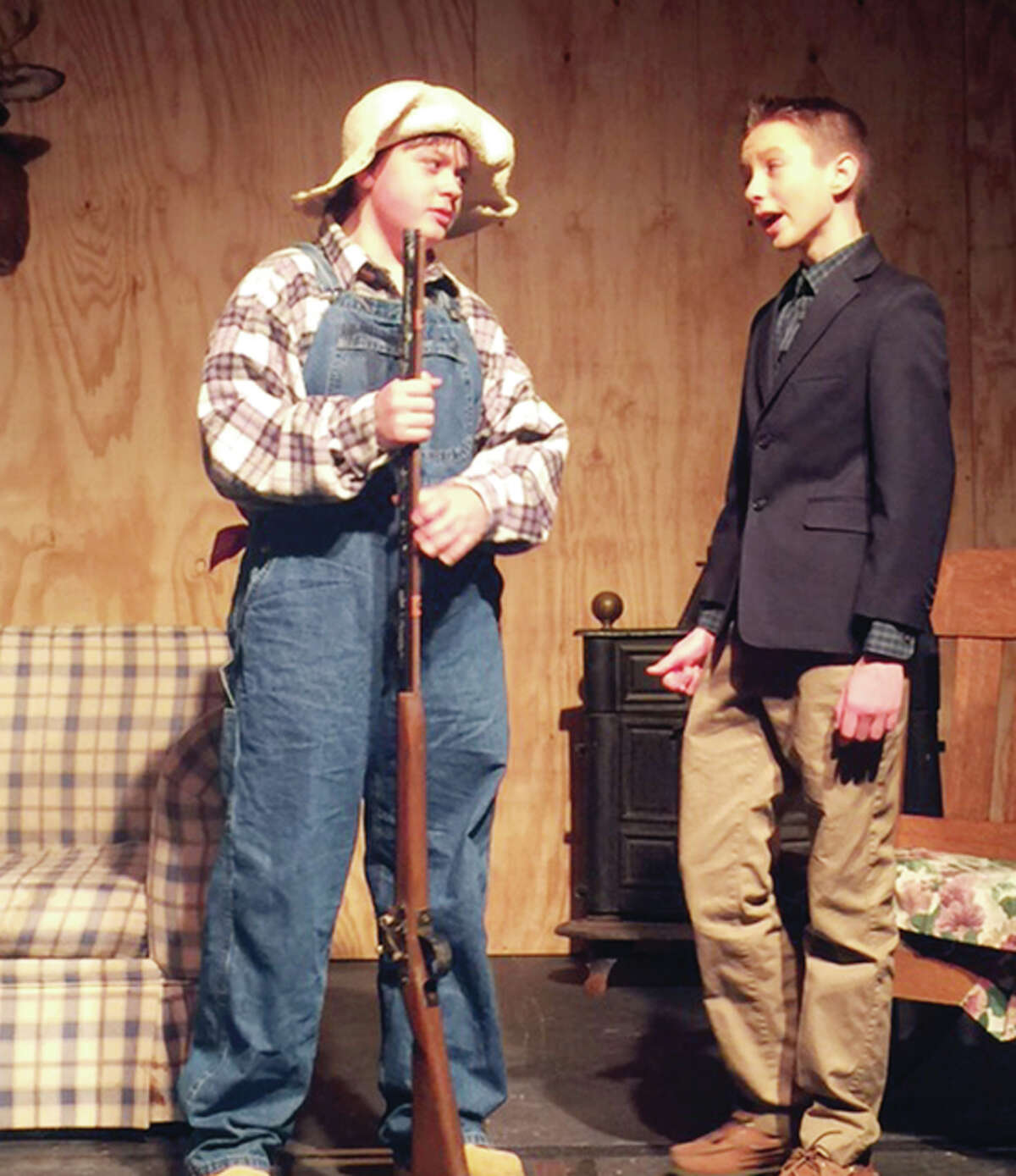 """Jonah Hutton (left), as Pa Hereford, and Max Bruner, as Marcus Slidell, rehearse a scene Tuesday from the comedy """"Hillbilly Hankerin'"""" in the Our Saviour School gym. The school's theater department will stage the play on Friday and Saturday."""