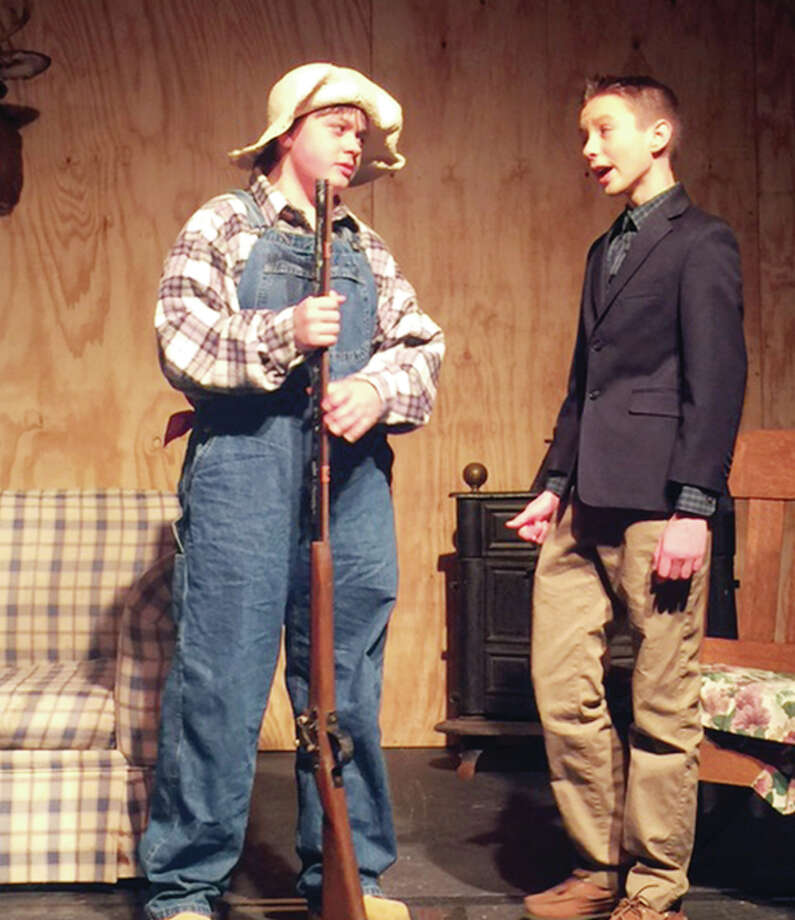 "Jonah Hutton (left), as Pa Hereford, and Max Bruner, as Marcus Slidell, rehearse a scene Tuesday from the comedy ""Hillbilly Hankerin'"" in the Our Saviour School gym. The school's theater department will stage the play on Friday and Saturday. Photo: Submitted Photo"