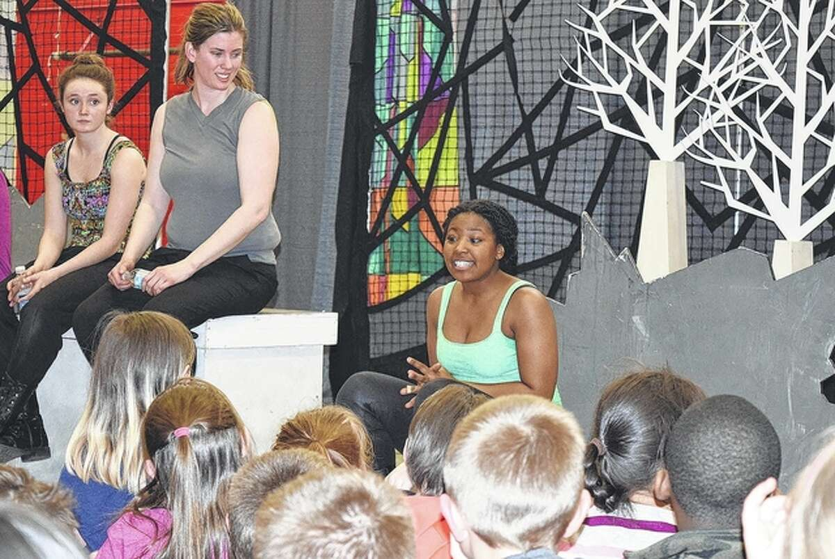 """Faith Servant (right), a member of The Shakespeare Festival St. Louis Education Tour, talks with students aboutthe play """"A Midsummer Night's Dream."""" The group performed Wednesday at Washington Elementary School as a part a series of shows in Jacksonville."""