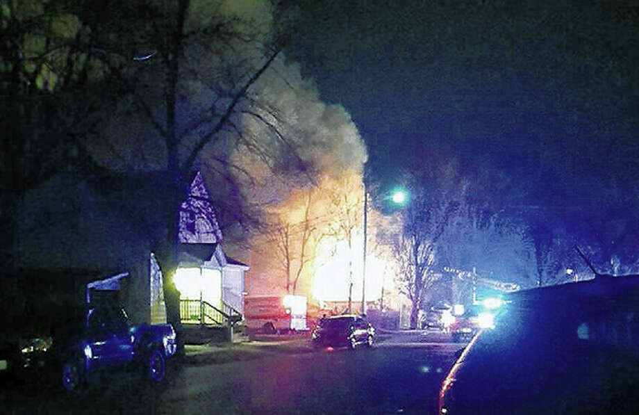 Fire rips through a Monroe Street house late Thursday. Photo: Starr Carroll | For The Journal-Courier