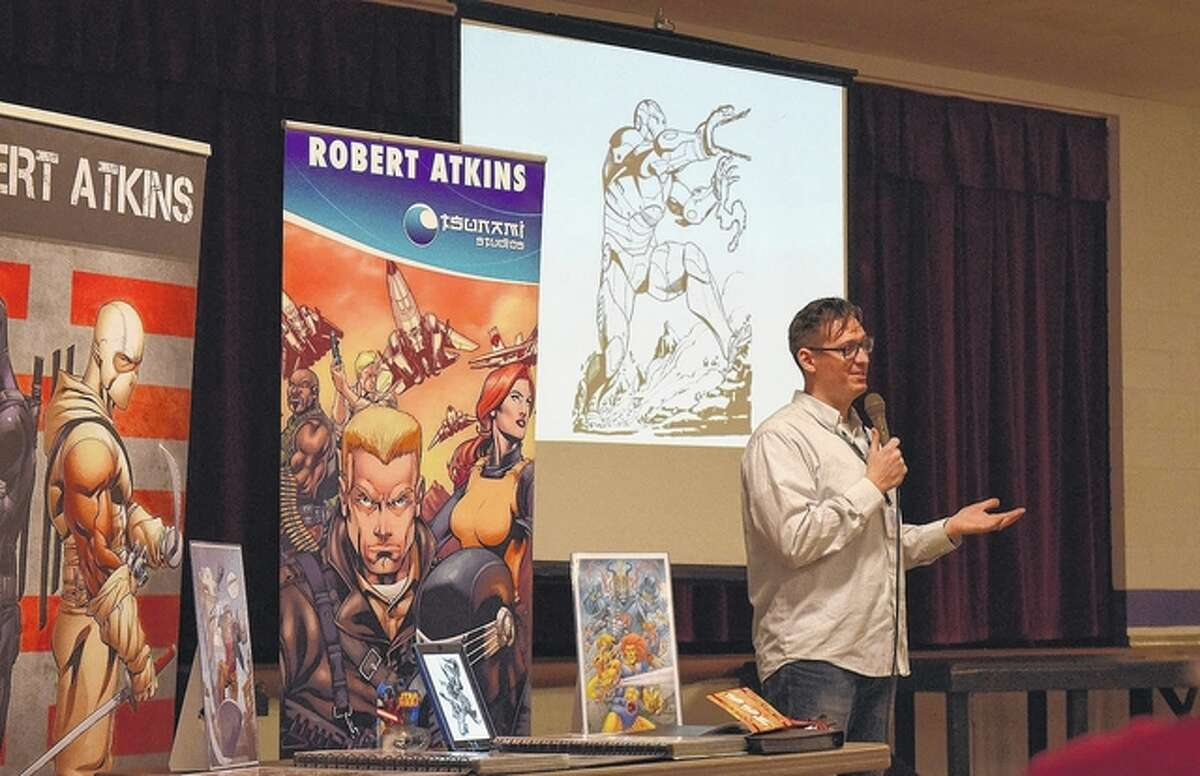 Comic book artist Robert Atkins talks with students about the art of comic book making Friday at Routt Catholic High School.