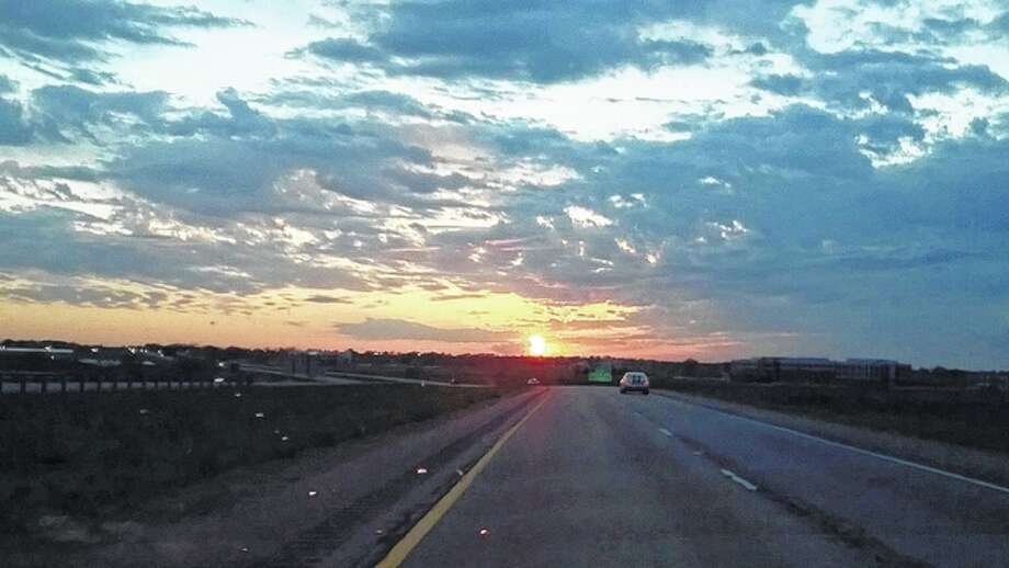 A car drives toward the approaching evening near Jacksonville. Photo: Lance Bruere | Reader Photo