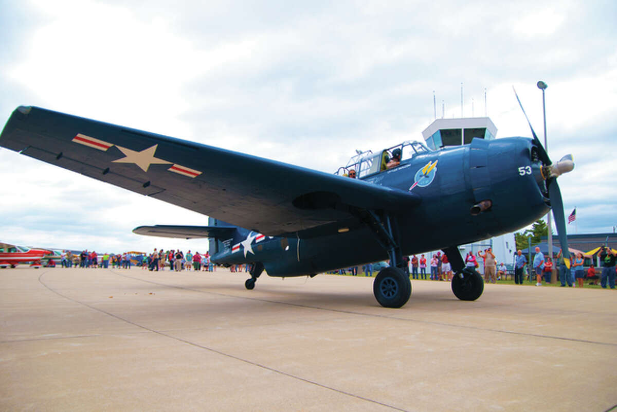 A vintage aircraft taxis to the runway with a passenger that paid $895 to take a short flight out of St. Louis Regional airport on Saturday afternoon.