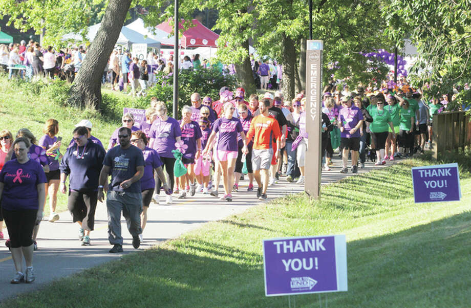 A long line of participants heads out at the start of the 2015 Walk to End Alzheimer's, held Saturday morning at Southern Illinois University Edwardsville. Volunteers estimated as many as 2,000 people participated in the walk, which raises both funds and awareness about Alzheimer's disease.