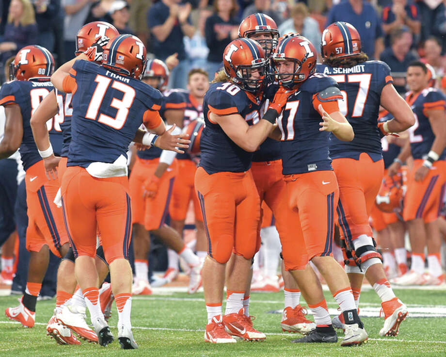 Illinois placekicker Taylor Zalewski (17) is congratulated by teammates after his 51-yard field goal late in Saturday's game against Middle Tennessee State at Memorial Stadium. The field goal turned out to be the game winner in the Illini's 27-25 victory. Photo: Cary Frye | For The Telegraph