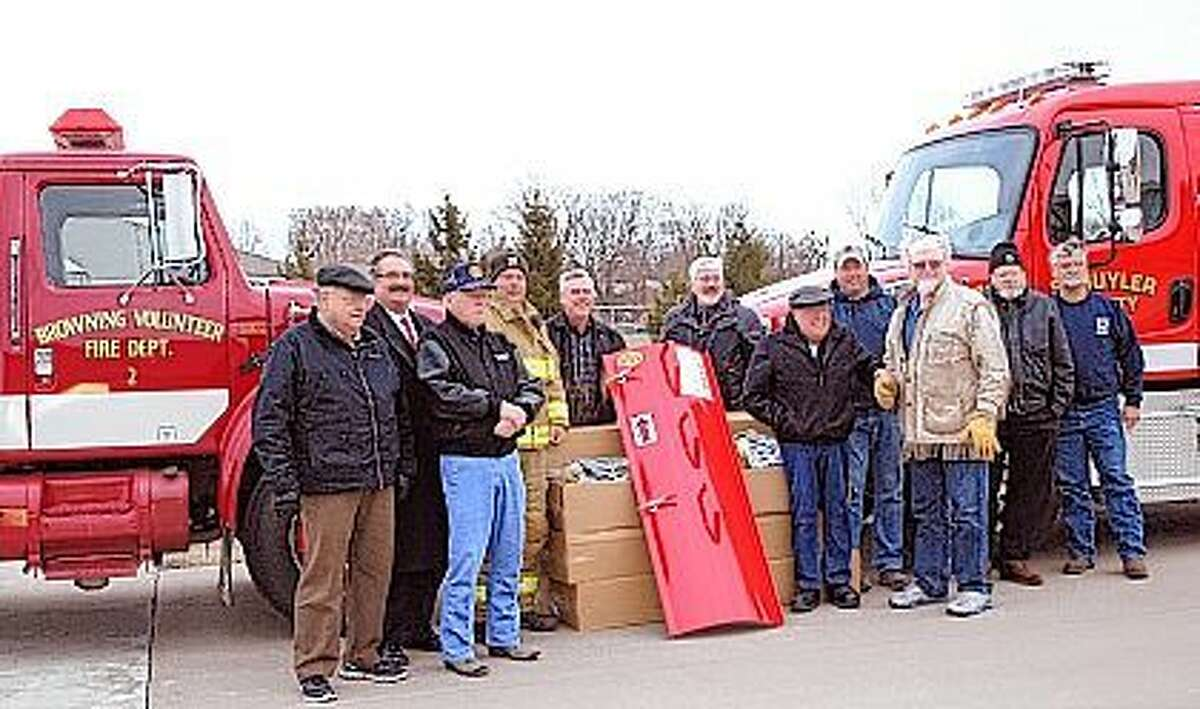 The Rushville Rotary Club delivers a set of grain bin rescue equipment to the Browning Fire Department. Shown here are firefighters from Browning and Rushville. Both departments will share in training to operate the equipment. Pictured are Rotarians Bill Worthington (from left), Brent Wood and Tom Desulis, Browning Fire Chief Jeff Boyd, Rotarians Dan Adams, Rob Kirkham and Bill Bartlow, firefighter Eric Stauffer, Rotarians Joe Bartlow and Ronnie Robeson and firefighter Vic Menely.