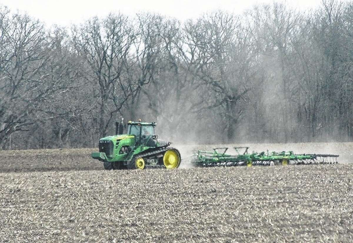 A farmer takes to a field in rural Macoupin County, getting ready for the spring growing season.