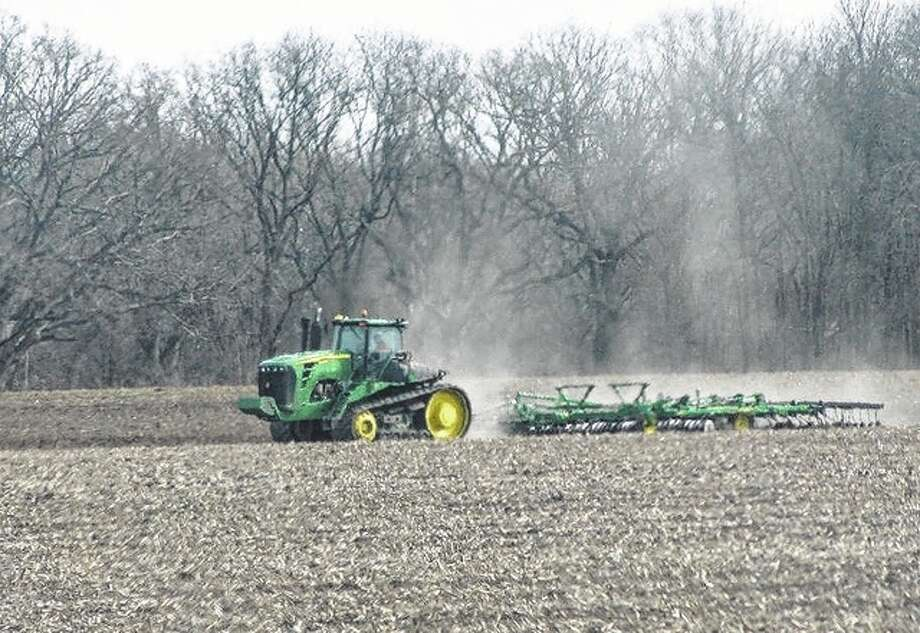 A farmer takes to a field in rural Macoupin County, getting ready for the spring growing season. Photo: Beverly Watkins | Reader Photo