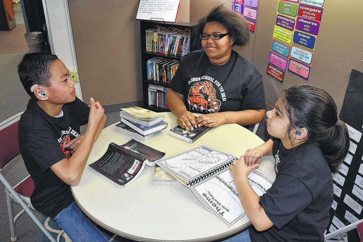 """Illinois School for the Deaf students Ian Fraas (from left), Olivia """"Libby"""" Scott and Valerie Eyer will compete in Battle of the Books, a national competition at Gallaudet University in Washington, D.C., in early April."""