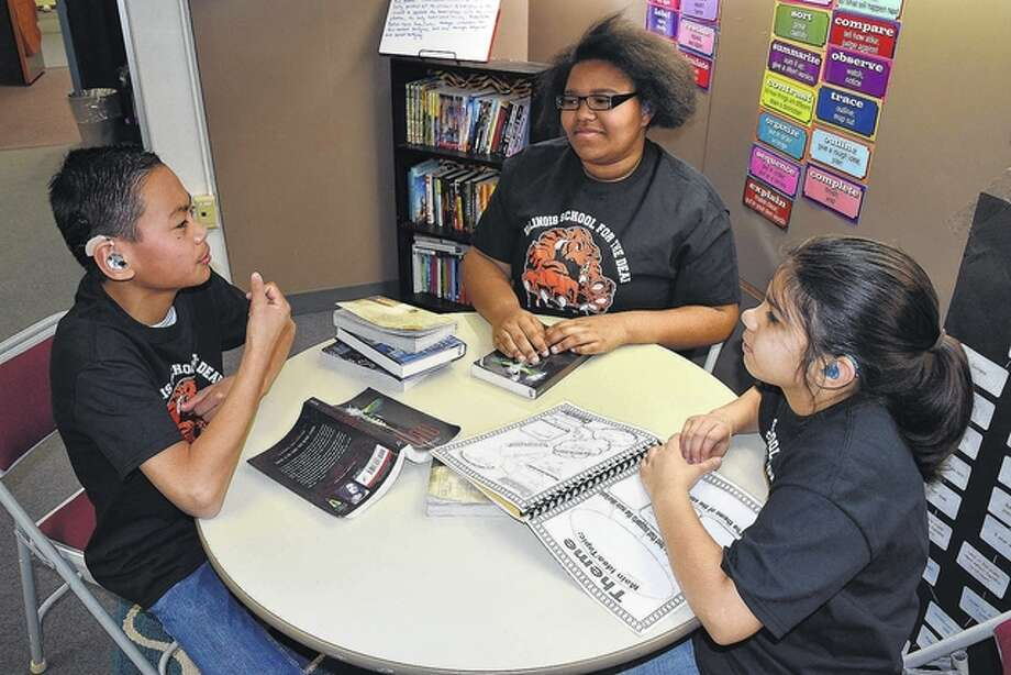 "Illinois School for the Deaf students Ian Fraas (from left), Olivia ""Libby"" Scott and Valerie Eyer will compete in Battle of the Books, a national competition at Gallaudet University in Washington, D.C., in early April. Photo: Greg Olson 