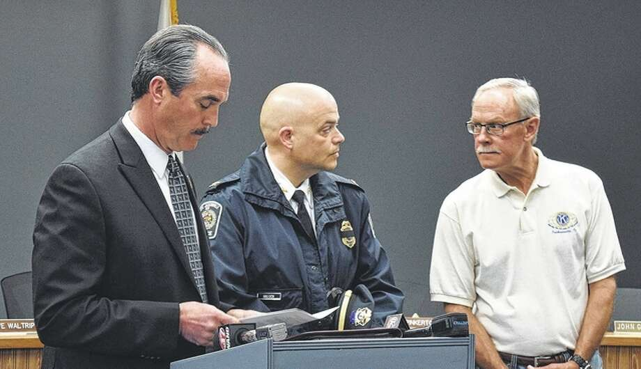 South Jacksonville resident Pat Staples (left), Police Chief Josh Hallock and village President Steve Waltrip discuss services for Officer Scot Fitzgerald during a news conference Monday.