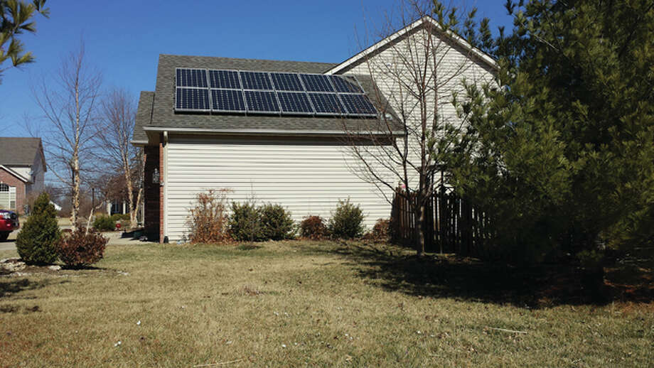 One stop on the Illinois Solar Energy Association's home tour is Chris Krusa's house located at 27 Rose Court in Glen Carbon. Krusa said his 12-panel array located on the south face of his garage is the only home solar installation currently in operation in Glen Carbon. Photo: For The Telegraph