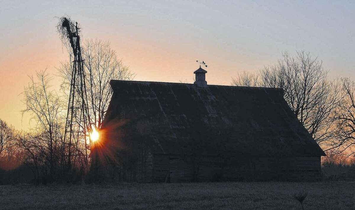 The sun rises on an old farmstead in Pike County.