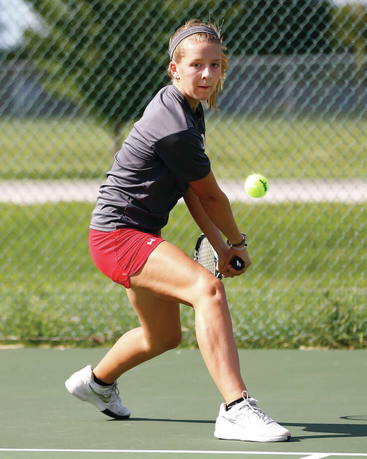 Alton's Abby Fischer, shown hitting a backhand during a win earlier this season, won singles and doubles matches Monday to help the Redbirds to an 8-1 Southwestern Conference dual victory over Collinsville. Photo: Billy Hurst / For The Telegraph