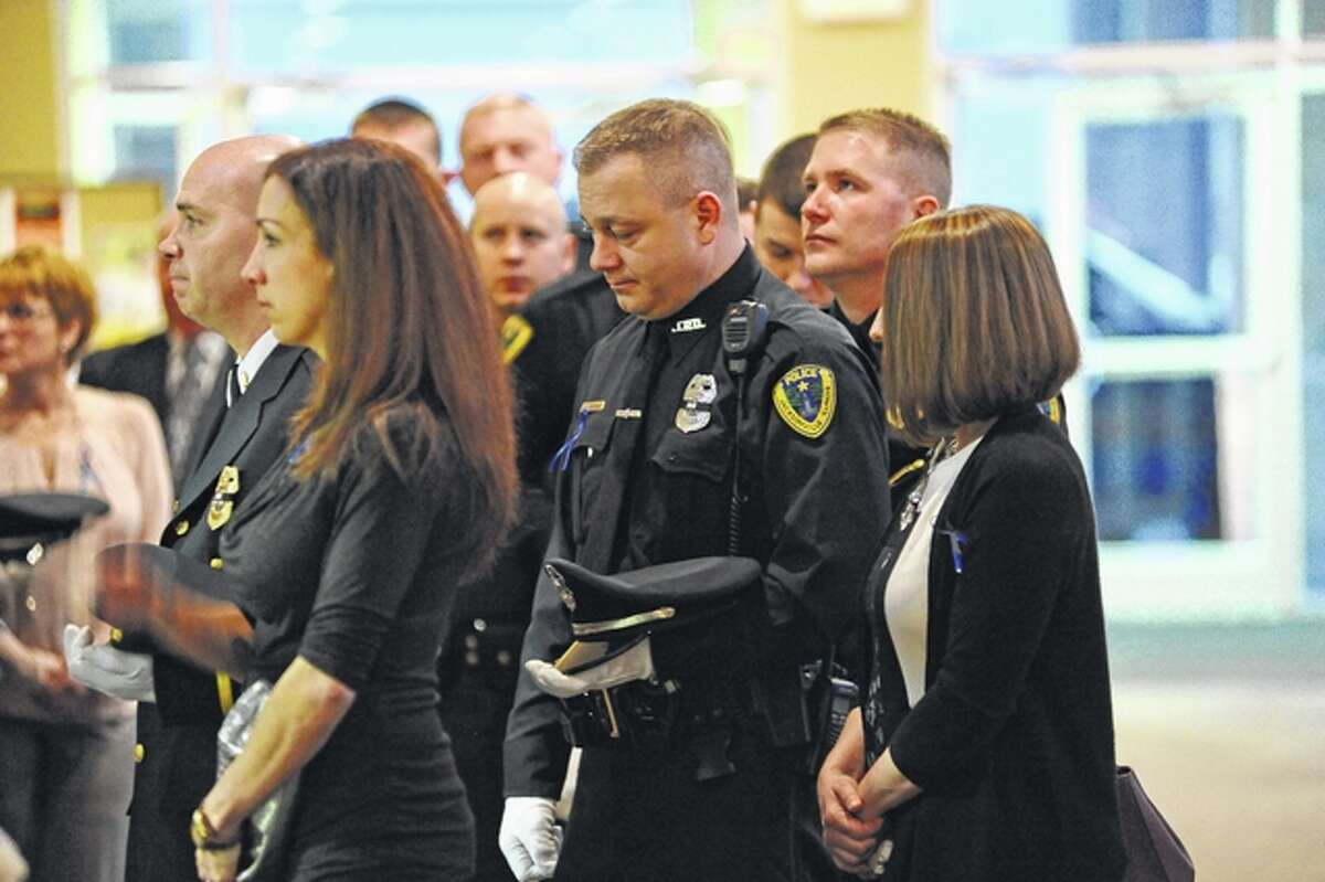 An emotional contingent of Jacksonville Police Department officers and their spouses attend the visitation for South Jacksonville Police Officer Scot Fitzgerald. Fitzgerald died Saturday, hours after his squad car and an ambulance collided on Illinois Route 267 as he was making a U-turn to respond to a call for assistance.