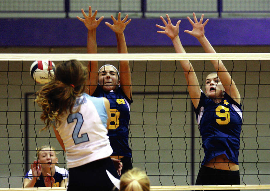 Jersey's Mackenzie Thurston (2) hammers home one of her team-leading 10 kills past the block of Civic Memorial's Sydney Marshall and Hannah Schmidt (8) in the Panthers' three-set Mississippi Valley Conference victory on Tuesday night in Bethalto. Photo: James B. Ritter / For The Telegraph
