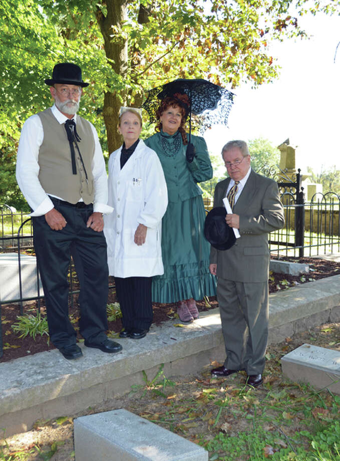 This year's Vintage Voices' featured docents include, from left, Jerome Minks as Henry Guest McPike, Loretta Williams as Demoy Wilson Schultz, Lee Cox as Celia French Lovejoy, and John Meehan as Walter Greer. The program will run from 1 to 3 p.m. each Saturday in October at the Alton City Cemetery. Photo: Vicki Bennington | For The Telegraph