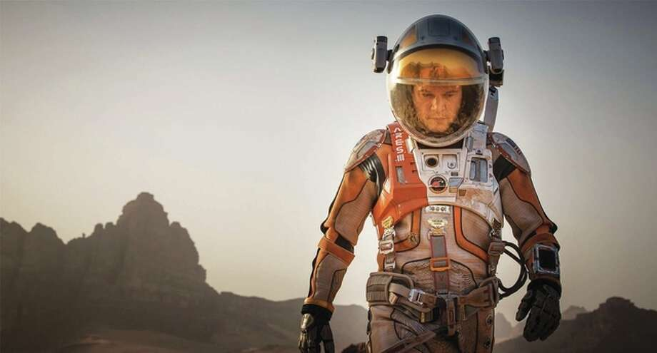 """In """"The Martian"""" astronaut/botanist Mark Watney played by Academy Award-winner Matt Damon, pictured, is presumed dead after being hit by a flying trajectory during a fierce sand storm. He is left behind on Mars by his crew when they must make an emergency exit from the planet. Photo: Fox 