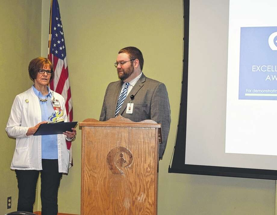 Passavant Hospital Vice President Karen Daum accepts the Saving Sight 2015 Excellence in Eye Donation Award from Robert Hamilton, partner relations coordinator for the organization. The hospital was honored for the number of eye donations last year. Photo: Samantha McDaniel-Ogletree | Journal-Courier