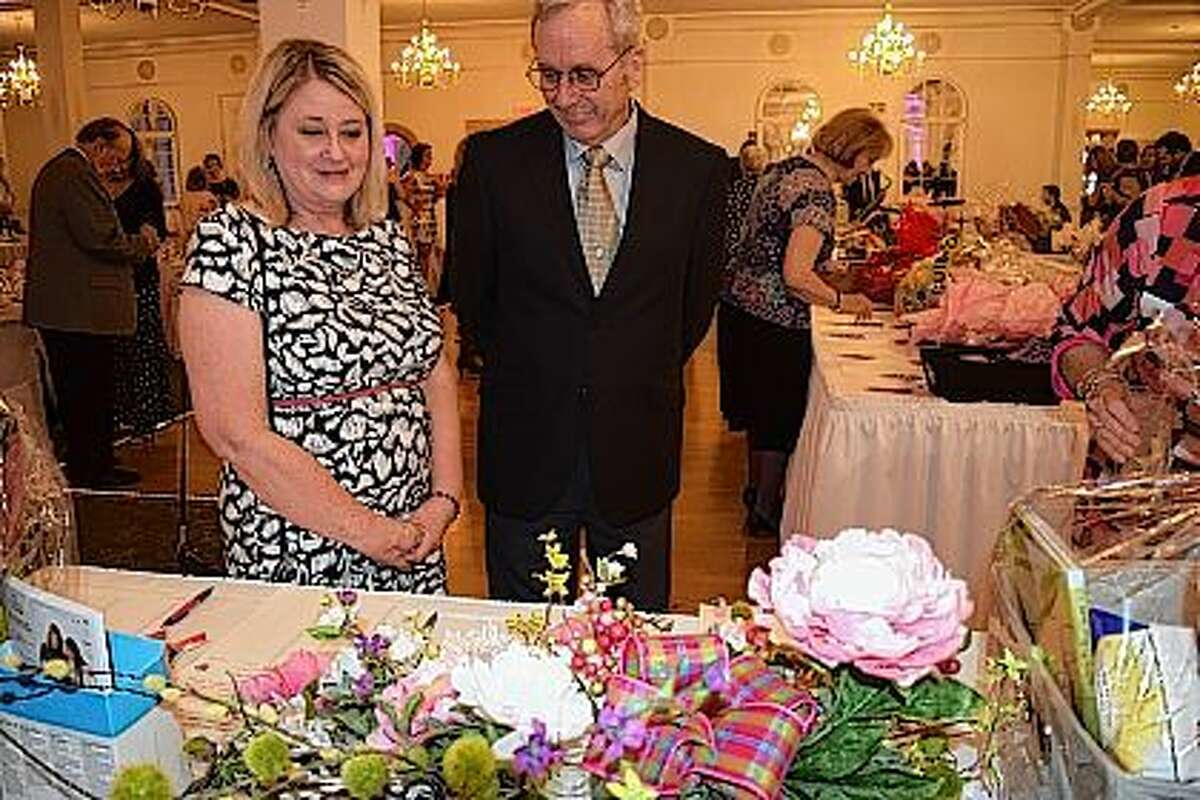 Patty and Wayne White, of Jacksonville, look at items in the silent auction during the Mia Ware Foundation's annual gala Friday night at Hamilton's 110 NE in Jacksonville.