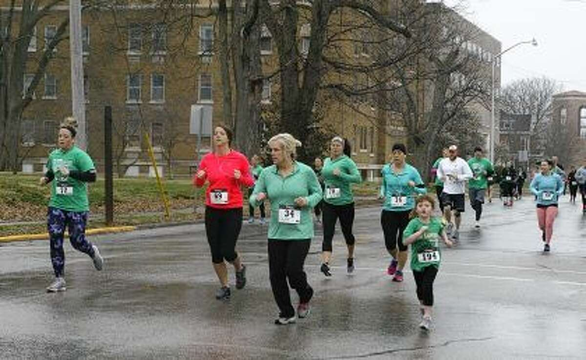 Runners leave the starting line Saturday near Our Saviour School during the school's Shamrock 5K.