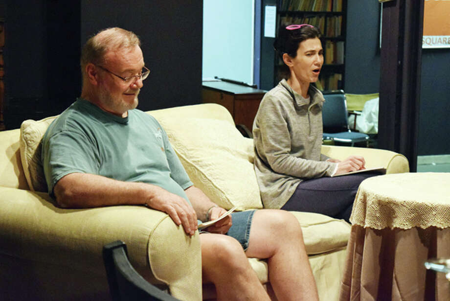"Mike Schneider (left) as Dr. Bradman and Sissy Brown as Ruth Condomine rehearse Monday for this weekend's production of ""Blithe Spirit"" at Playhouse on the Square in downtown Jacksonville. Photo: Nick Draper 