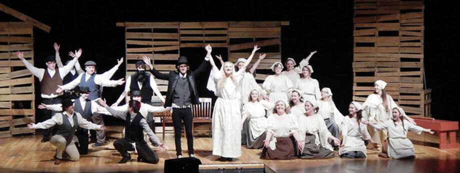 "The cast of Jacksonville High School's production of ""Fiddler on the Roof"" rehearses Monday in the JHS auditorium. Photo: Photos By Angela Bauer 