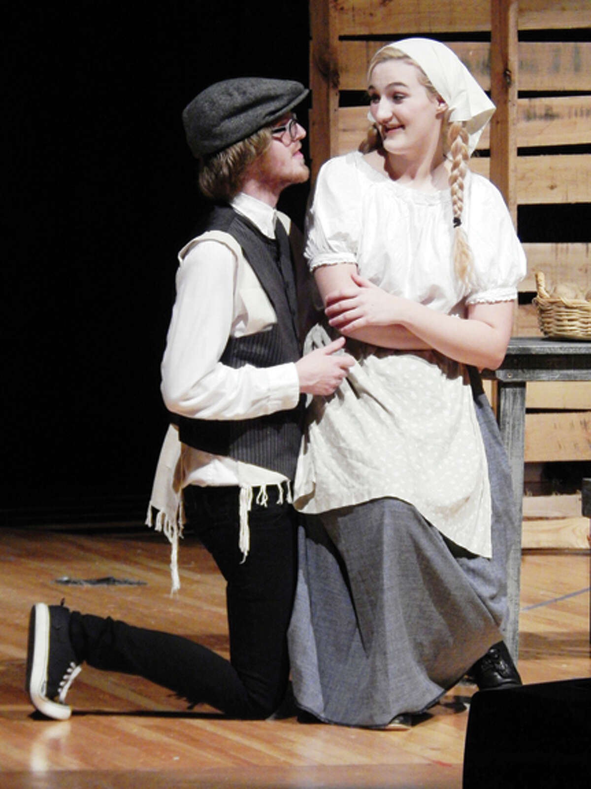 Zach Chamberlain as Motel the tailor and Emily Miner as Tzeitel share a scene during rehearsals Monday at the high school.