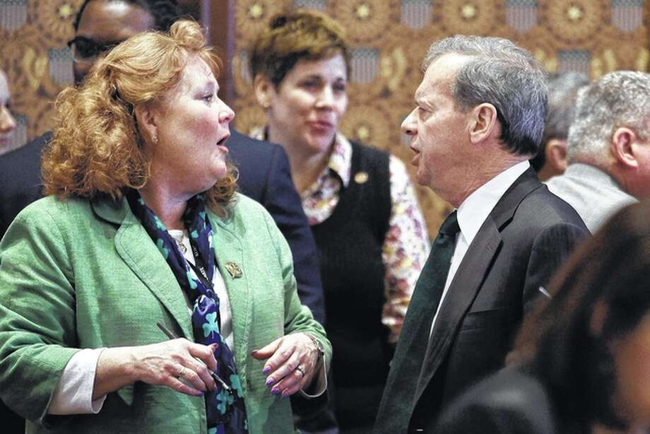 Seth Perlman | AP Senate President John Cullerton (right) talks with Sen. Laura Murphy, D-Park Ridge, while on the Senate floor during session Thursday in Springfield.