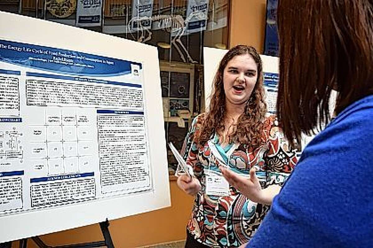 Rachel Buente, a junior international studies major at Illinois College, presents her research on the life cyle of rice Friday at the second biennial International Symposium on Science, Sustainability and Teaching.
