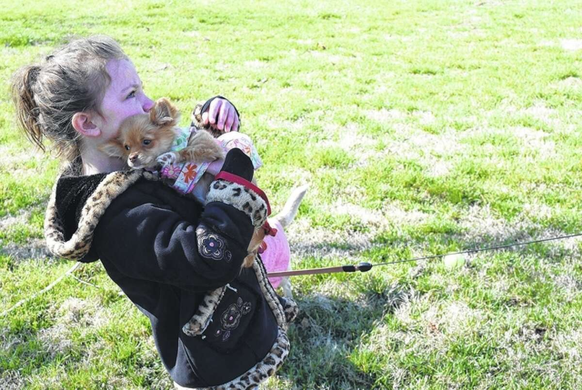 Hanna Dixon holds her 4-month-old Chihuahua, Gracia, Saturday during the Bark Park Bunny Bash.