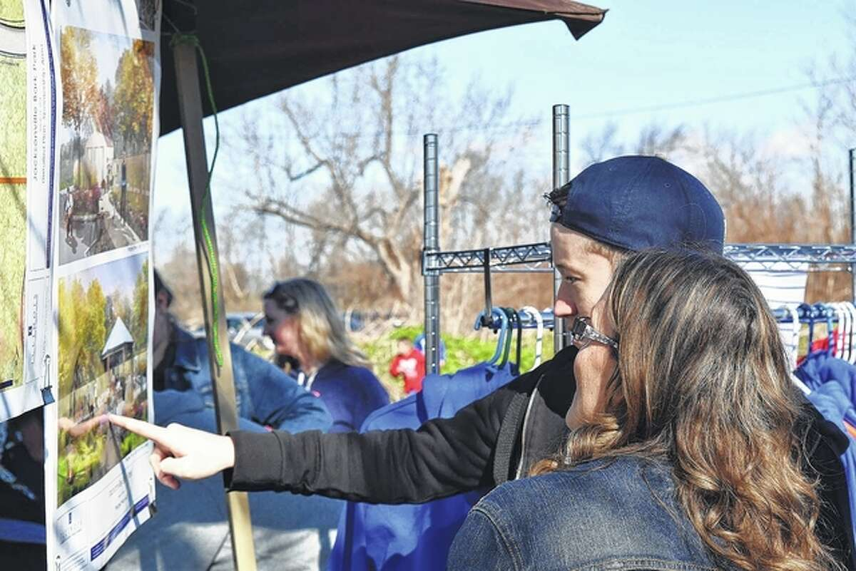 Tyler and Luanne Cain look at the Bark Park site plans Saturday during the Bark Park Bunny Bash.